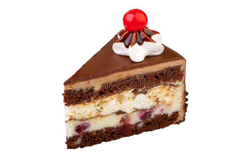 Κομμάτι του κέικ σε ένα άσπρο υπόβαθρο στοκ φωτογραφία