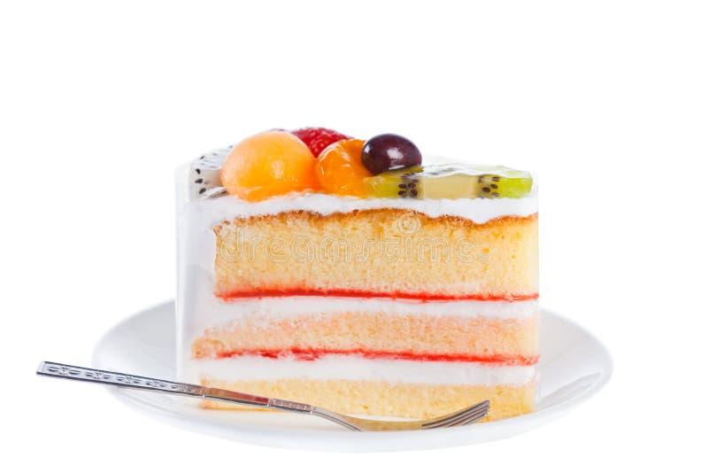 Κομμάτι του dilicious κέικ, που απομονώνεται στο άσπρο υπόβαθρο στοκ εικόνα