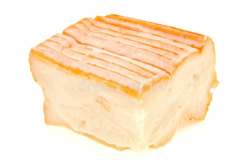 Κομμάτι Munster του τυριού σε ένα άσπρο υπόβαθρο στοκ εικόνες με δικαίωμα ελεύθερης χρήσης