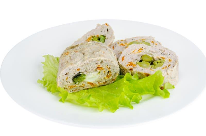 Κομματιασμένο meatloaf με το μπρόκολο και το πράσινο salat στοκ φωτογραφίες
