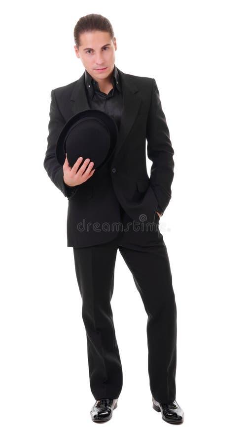 Κομψός νεαρός άνδρας στο μαύρο κοστούμι στοκ εικόνα με δικαίωμα ελεύθερης χρήσης