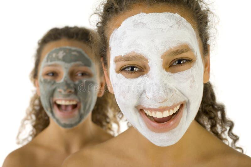 κορίτσια ευτυχής mask spa στοκ εικόνες