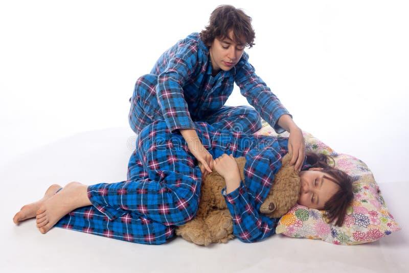 Κορίτσια στις μπλε πυτζάμες στοκ φωτογραφίες