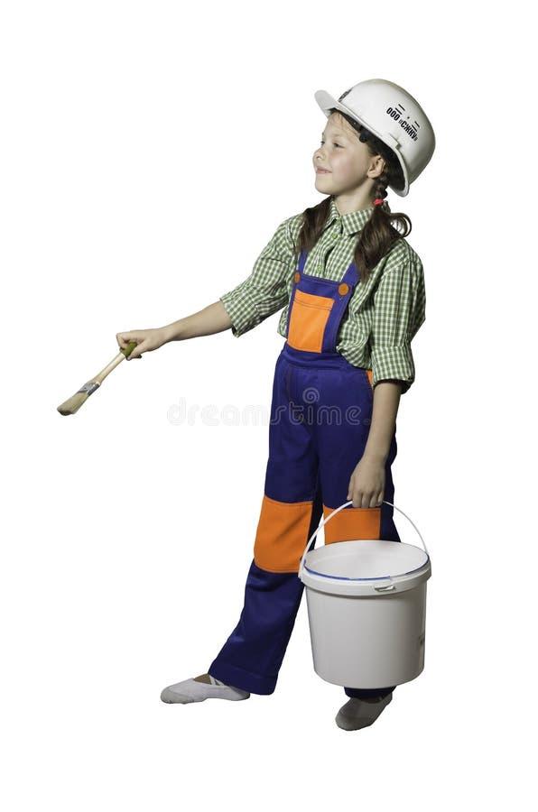 Κορίτσι, έφηβος με τα εργαλεία για την επισκευή και κατασκευή, στις φόρμες και το κράνος, που απομονώνονται στοκ εικόνες
