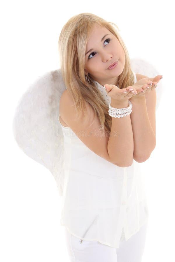 Κορίτσι αγγέλου που φυσά στα χέρια στοκ φωτογραφία με δικαίωμα ελεύθερης χρήσης
