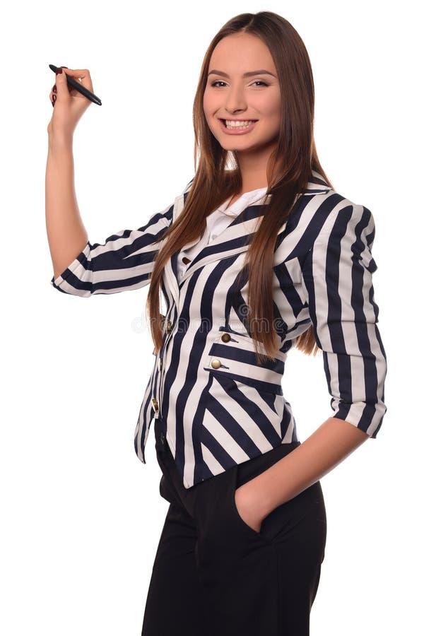 Κορίτσι γραφείων που παρουσιάζει μάνδρα που απομονώνεται σε ένα άσπρο υπόβαθρο στοκ εικόνες