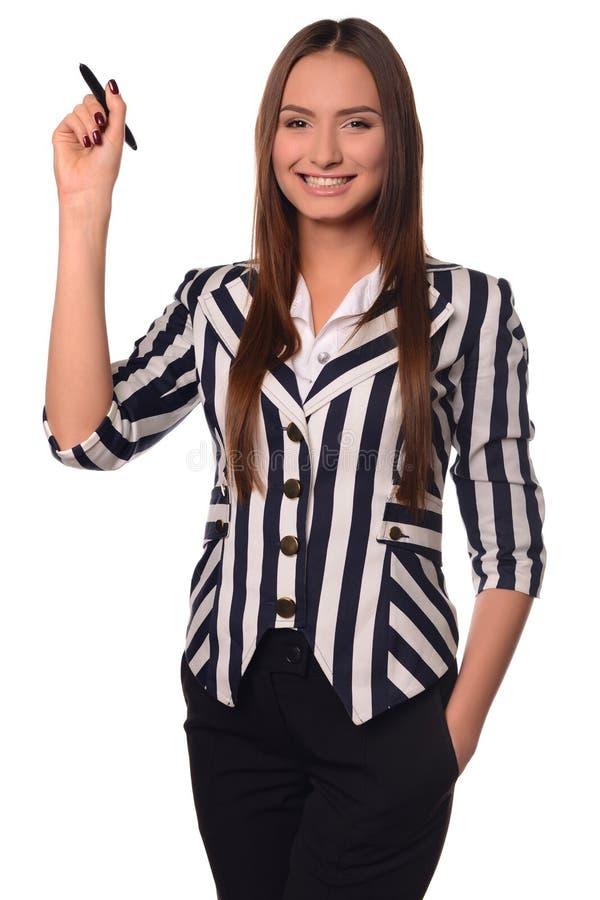 Κορίτσι γραφείων που παρουσιάζει μάνδρα σε ένα άσπρο υπόβαθρο στοκ εικόνα με δικαίωμα ελεύθερης χρήσης