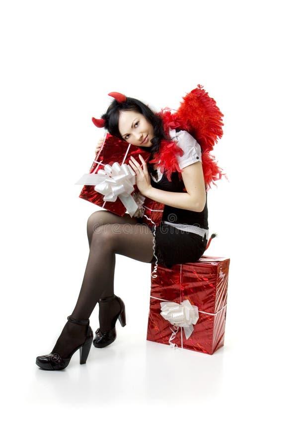 κορίτσι δώρων διαβόλων κο& στοκ εικόνες