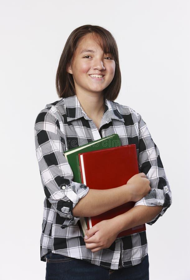 Κορίτσι εφήβων με τα σχολικά βιβλία στοκ εικόνα