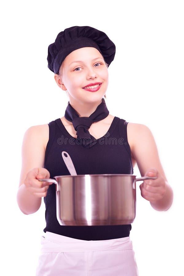 Κορίτσι εφήβων με το τηγάνι και την κουτάλα στοκ εικόνες με δικαίωμα ελεύθερης χρήσης