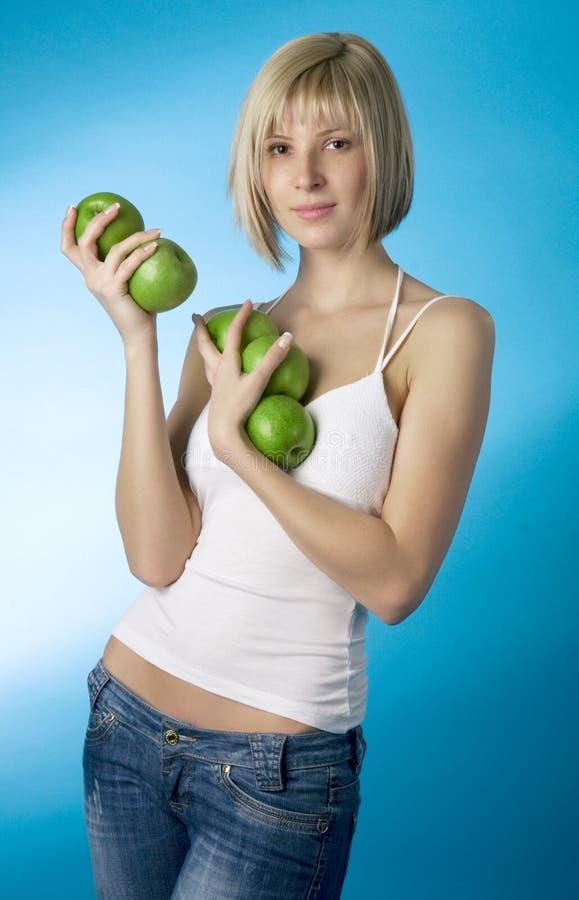 κορίτσι μήλων πράσινο στοκ εικόνα