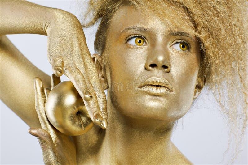 Download κορίτσι μήλων χρυσό στοκ εικόνα. εικόνα από πολύ, πολυτέλεια - 17050115