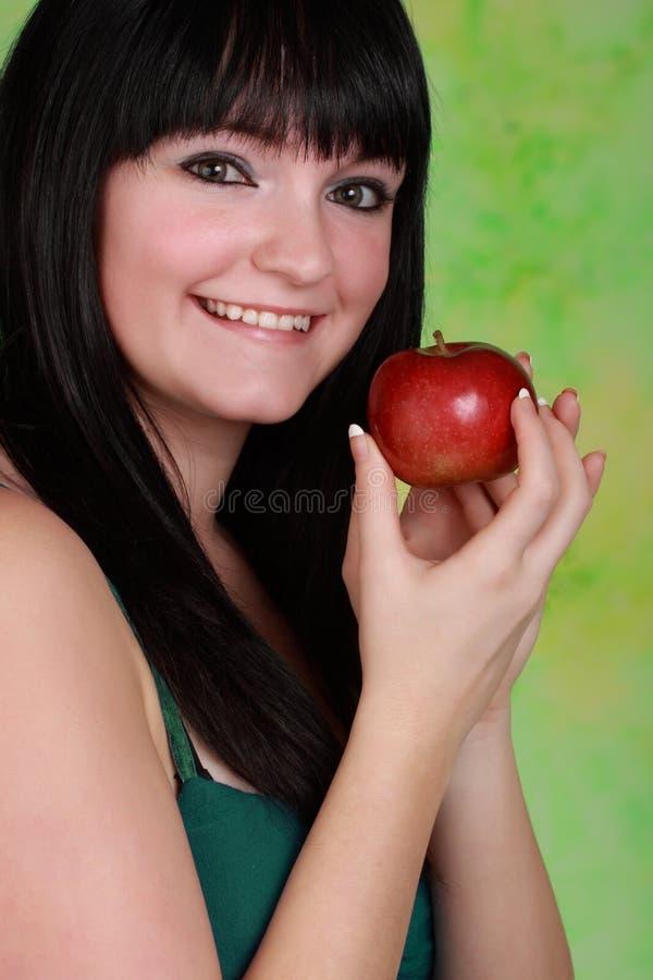 κορίτσι μήλων holdign στοκ φωτογραφία με δικαίωμα ελεύθερης χρήσης