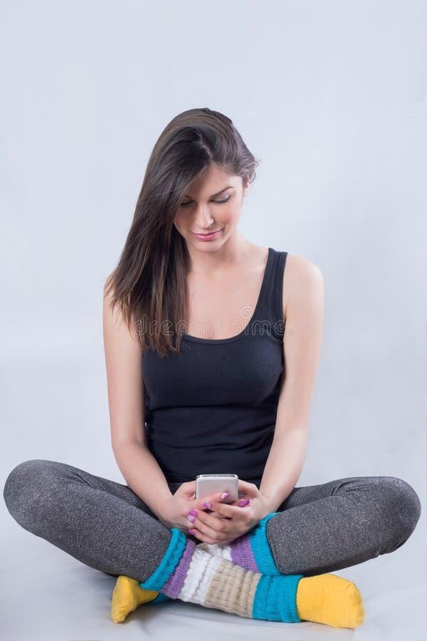 Κορίτσι με ένα τηλέφωνο στοκ εικόνες
