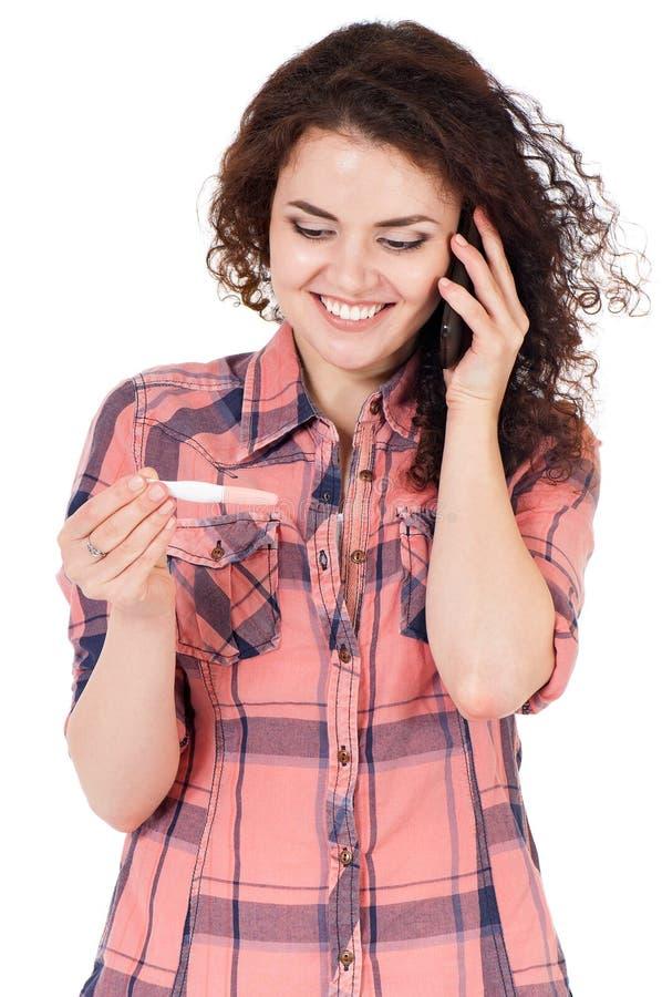 Κορίτσι με τη δοκιμή εγκυμοσύνης στοκ εικόνα με δικαίωμα ελεύθερης χρήσης