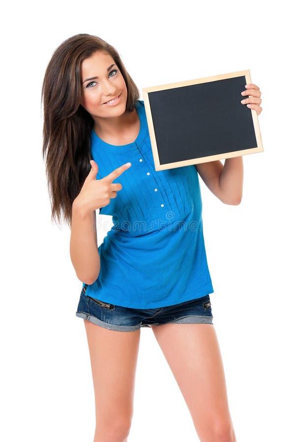 Κορίτσι με τον πίνακα στοκ εικόνα με δικαίωμα ελεύθερης χρήσης