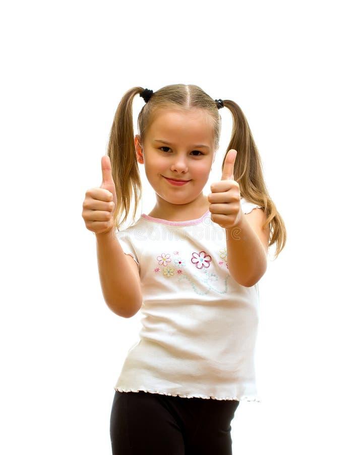 Κορίτσι με τους αντίχειρες επάνω. στοκ φωτογραφία