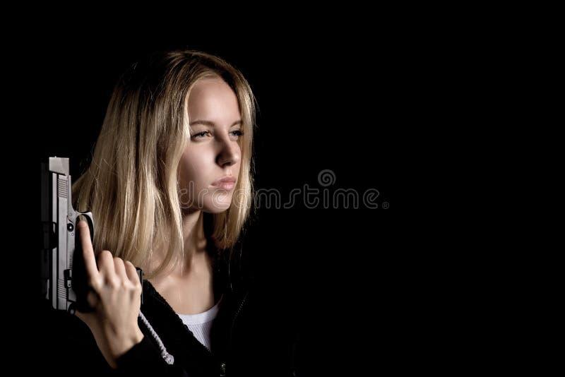 Κορίτσι με το πυροβόλο όπλο στοκ εικόνες