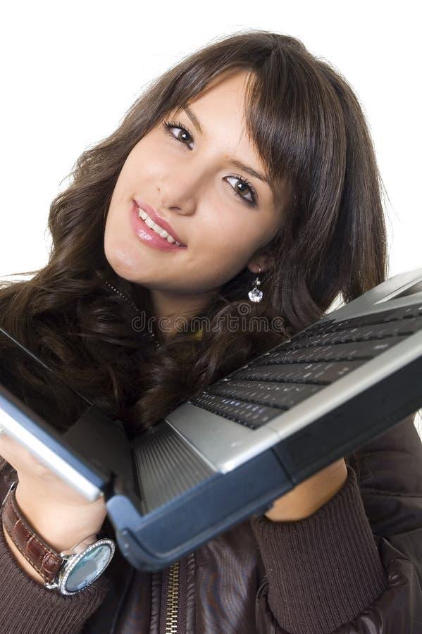 Κορίτσι με το φορητό υπολογιστή στοκ εικόνες
