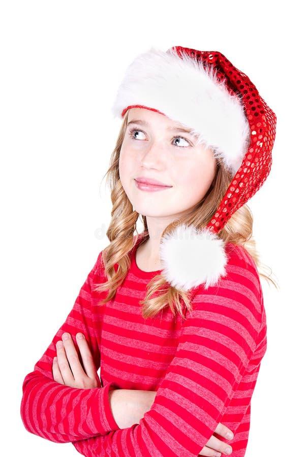 Κορίτσι παιδιών ή εφήβων που φορά ένα καπέλο Santa στοκ φωτογραφίες με δικαίωμα ελεύθερης χρήσης
