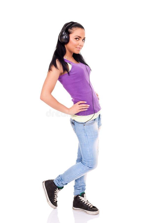 Κορίτσι που απολαμβάνει στη μουσική στοκ εικόνες