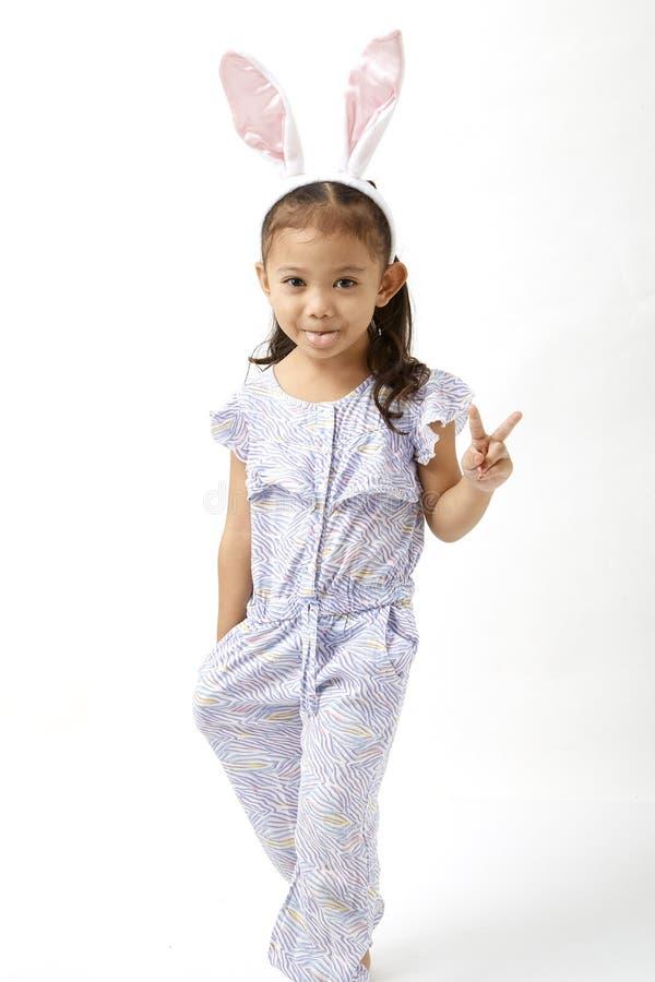 Κορίτσι που ενεργεί ως λίγη ημέρα Πάσχας στοκ εικόνες