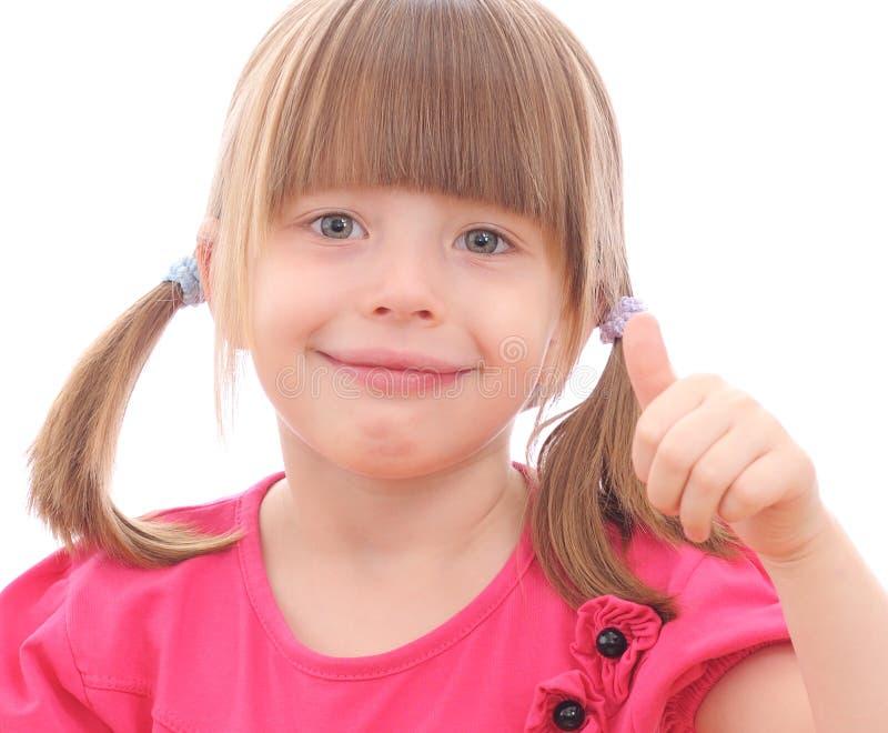 Κορίτσι που παρουσιάζει ΕΝΤΆΞΕΙ στοκ φωτογραφία