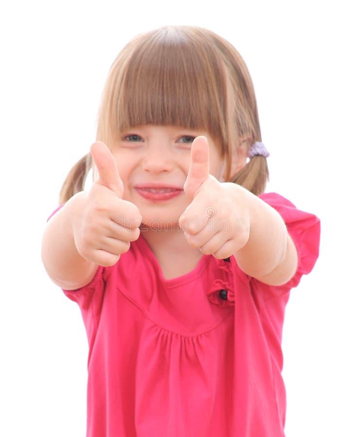 Κορίτσι που παρουσιάζει ΕΝΤΆΞΕΙ στοκ εικόνες