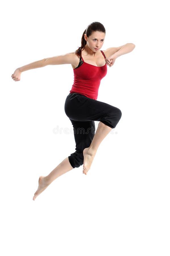 κορίτσι που πηδά πέρα από sportswear το λευκό στοκ εικόνες