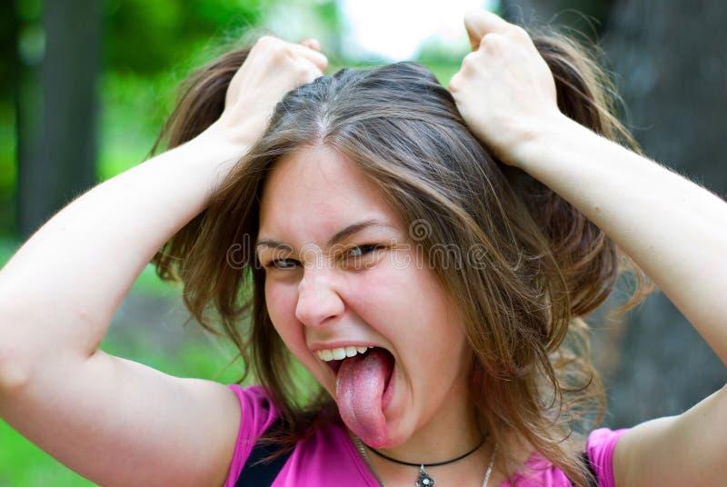 κορίτσι προσώπου που κάν&epsi στοκ εικόνα με δικαίωμα ελεύθερης χρήσης