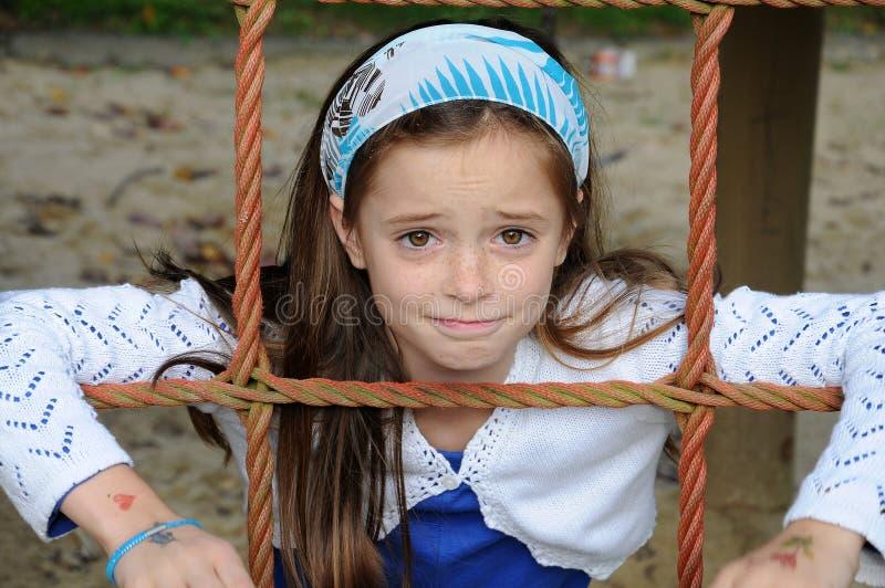 Κορίτσι στην παιδική χαρά στοκ φωτογραφία με δικαίωμα ελεύθερης χρήσης