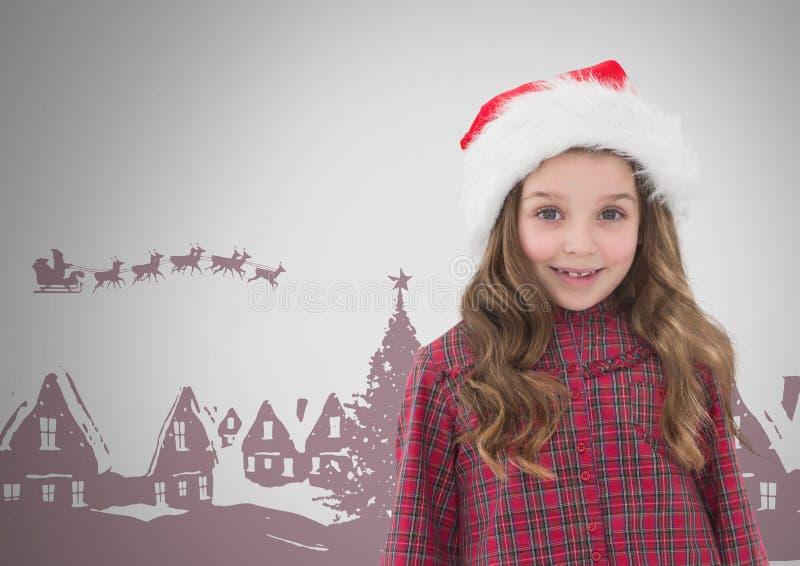 Κορίτσι στο γκρίζο κλίμα με το καπέλο Χριστουγέννων Santa και τις απεικονίσεις Χριστουγέννων στοκ φωτογραφία