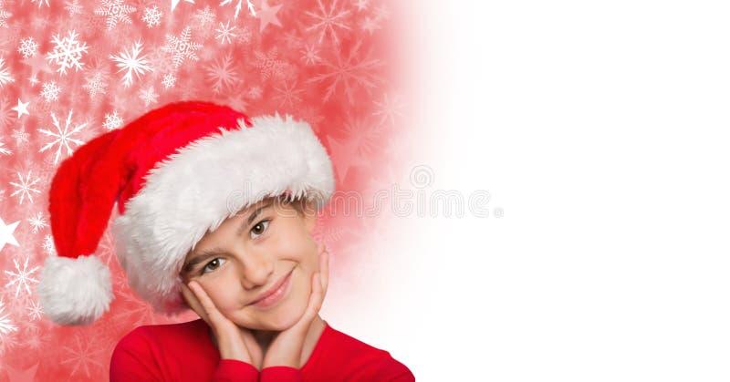 Κορίτσι στο καπέλο Santa και Snowflake το σχέδιο Χριστουγέννων και το κενό διάστημα στοκ εικόνες