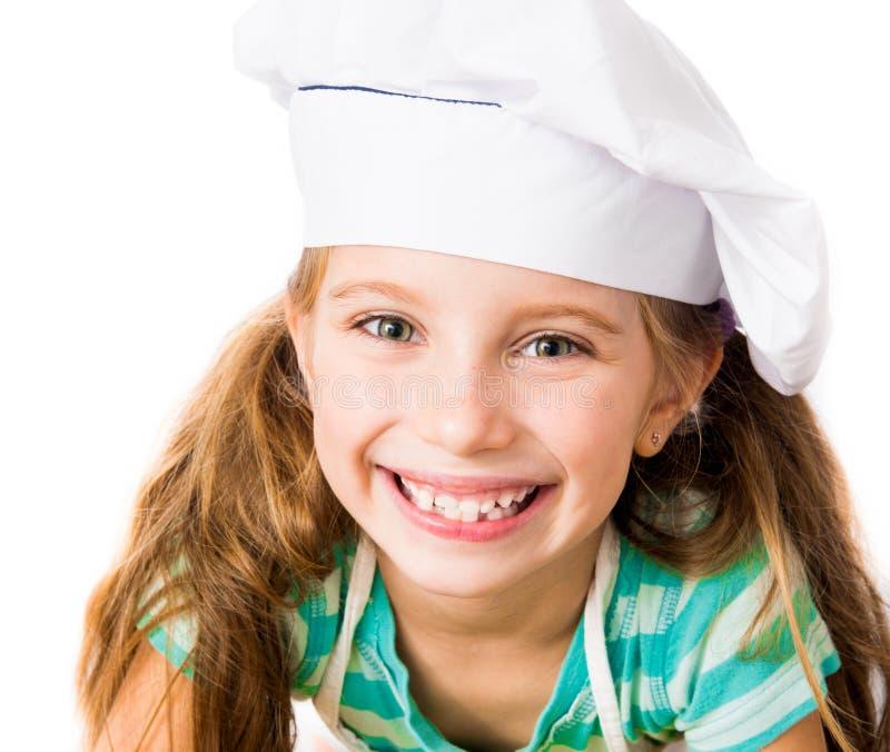 Κορίτσι στο καπέλο αρχιμαγείρων στοκ φωτογραφίες με δικαίωμα ελεύθερης χρήσης
