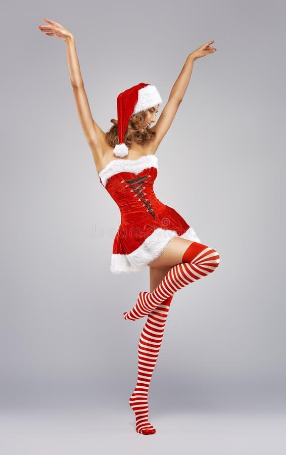 Κορίτσι στο φόρεμα Santa στοκ εικόνες