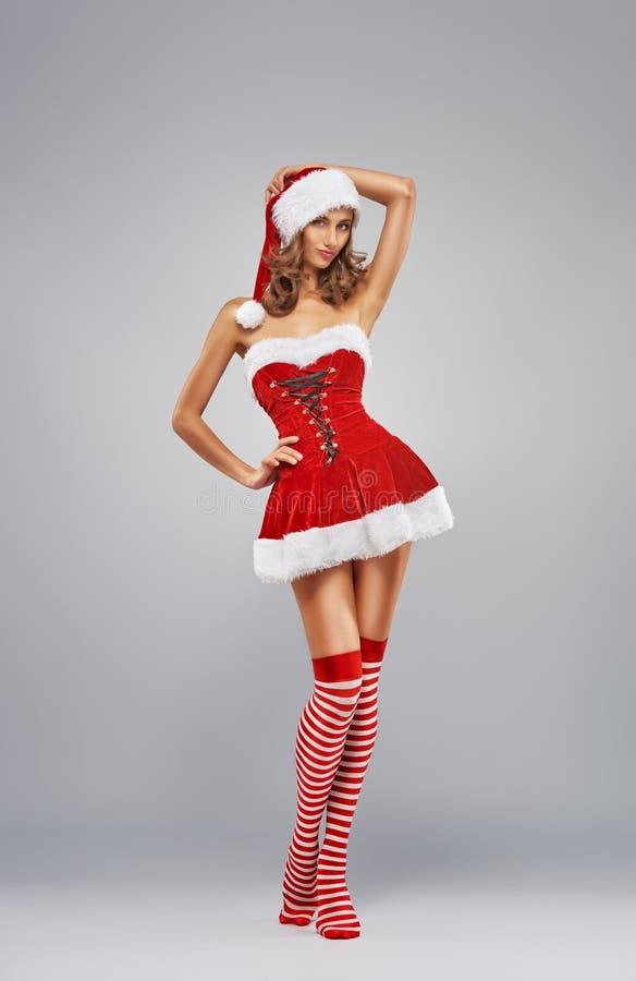 Κορίτσι στο φόρεμα Santa στοκ φωτογραφία με δικαίωμα ελεύθερης χρήσης