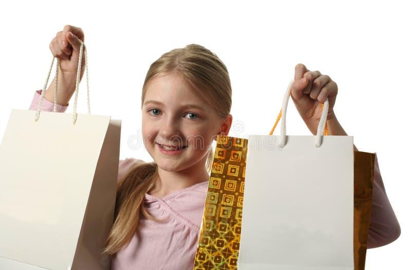 κορίτσι τσαντών που κρατά τις αρκετά αγορές στοκ εικόνα