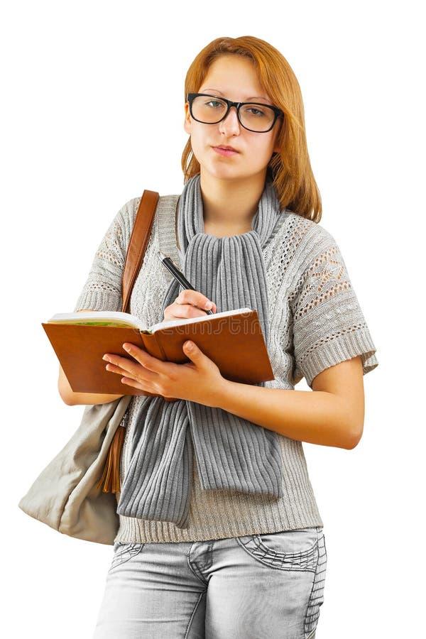 Κορίτσι Hipster που γράφει με τη μάνδρα ballpoint στοκ εικόνα