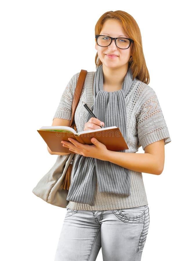 Κορίτσι Hipster που γράφει στο σημειωματάριο στοκ εικόνες