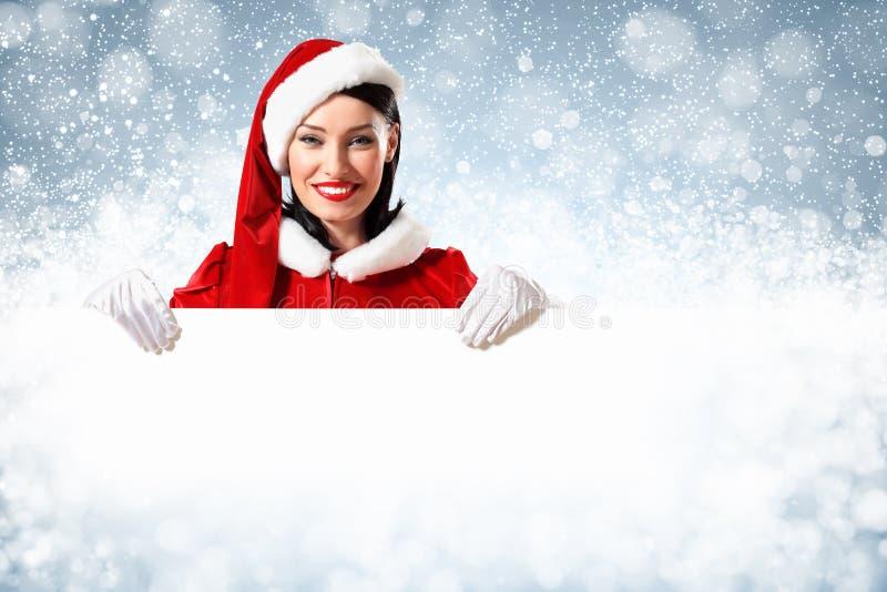 Κορίτσι Santa με ένα κενό έμβλημα στοκ φωτογραφία με δικαίωμα ελεύθερης χρήσης
