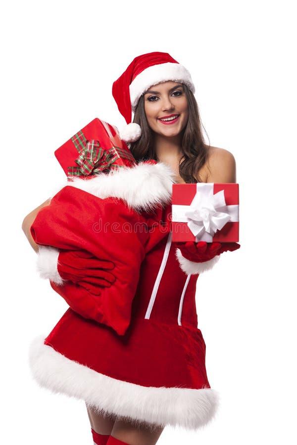 Κορίτσι Santa με τα δώρα στοκ φωτογραφίες με δικαίωμα ελεύθερης χρήσης
