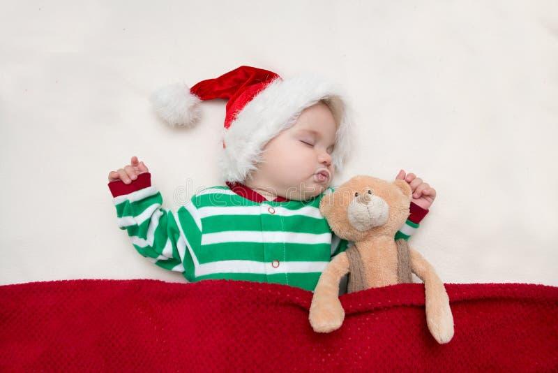 Κοριτσάκι Άγιος Βασίλης ύπνου στοκ φωτογραφίες