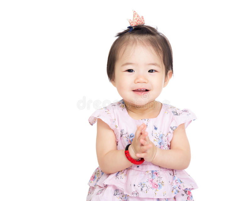 Κοριτσάκι της Ασίας που χτυπά το χέρι στοκ εικόνες