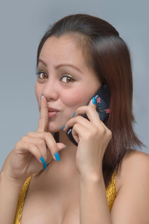 κοριτσιών κινητών τηλεφώνων στοκ εικόνα