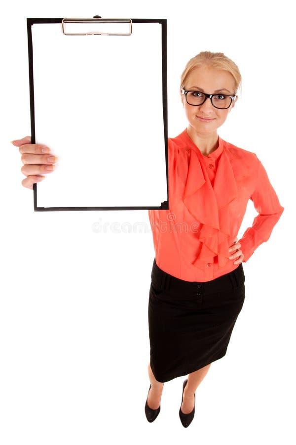 Κορυφαία όψη του νέου κενού λευκού χαρτονιού εκμετάλλευσης γυναικών στοκ φωτογραφία με δικαίωμα ελεύθερης χρήσης