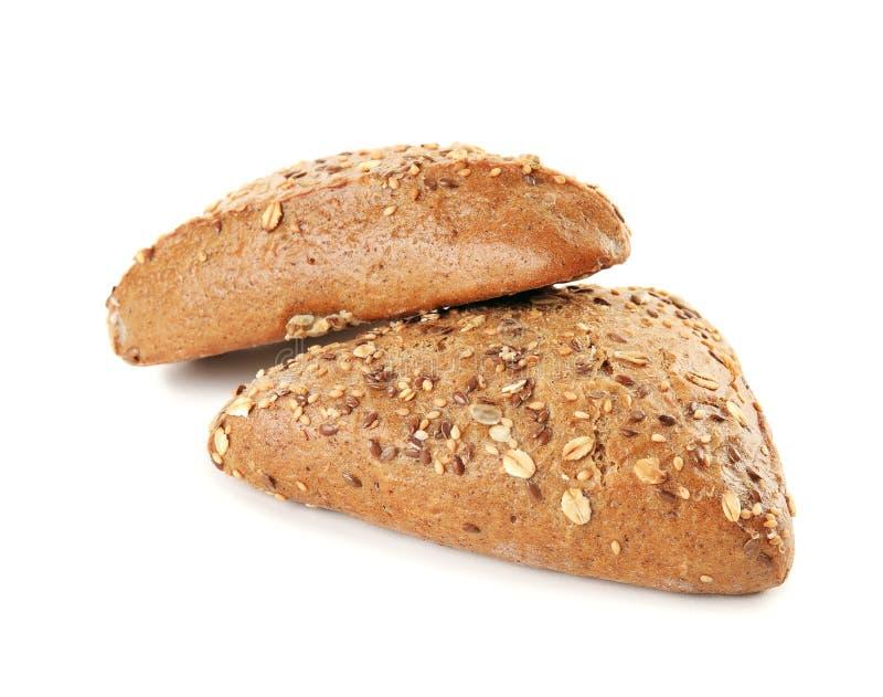Κουλούρια τριγώνων με τους σπόρους στο λευκό Wholegrain ψωμί στοκ φωτογραφίες