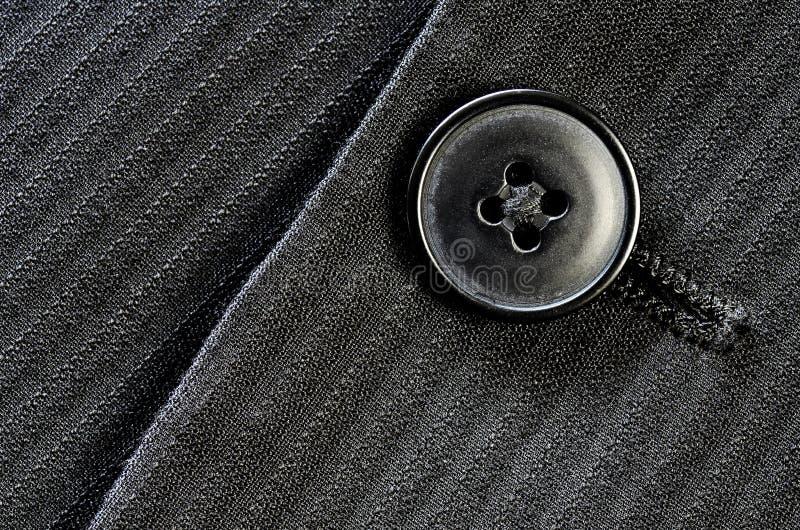 Κουμπί παλτών κοστουμιών στοκ εικόνα με δικαίωμα ελεύθερης χρήσης