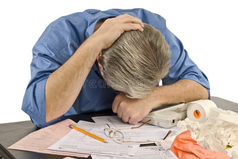 Κουρασμένος των φορολογικών προβλημάτων στοκ εικόνες