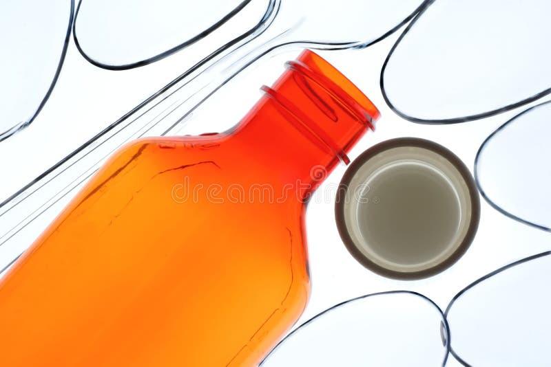 κουτάλια συνταγών μπουκαλιών στοκ φωτογραφία