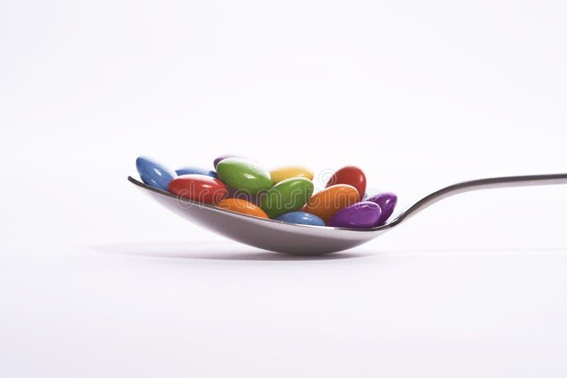 Κουτάλι με τα γλυκά στοκ φωτογραφίες
